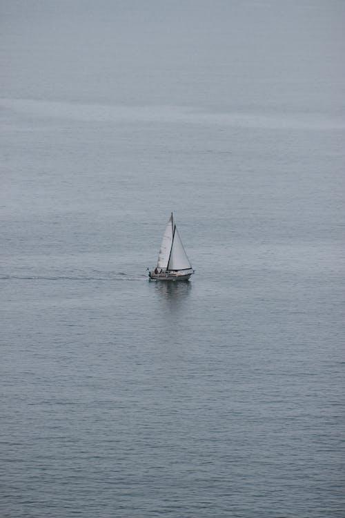 Sailboat floating on calm sea