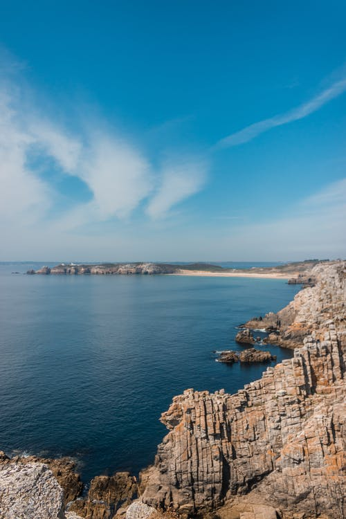 Spectacular scenery of rocky shore under blue sky on sunny day in summer