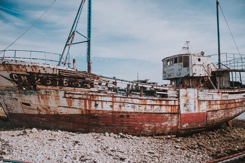 Old fishing ship on shore