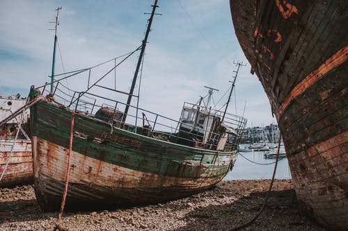 Old ships on wet shore