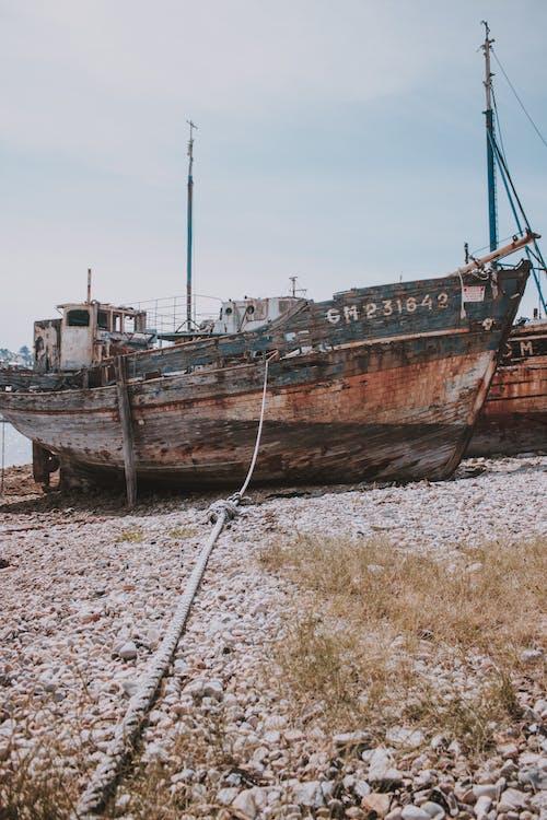 Shabby fishing boat on coast