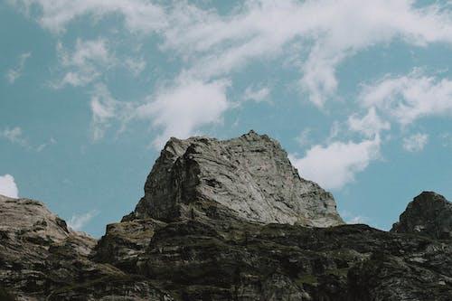 Rocky mountain slope on sunny day