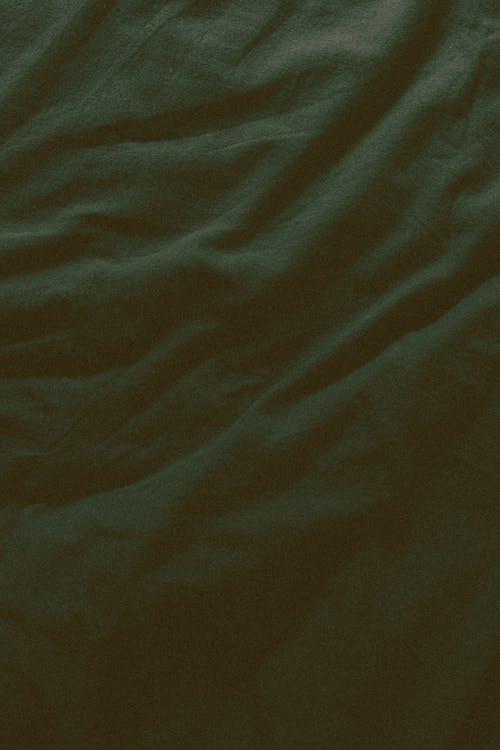 Crumpled sheet surface in dark light