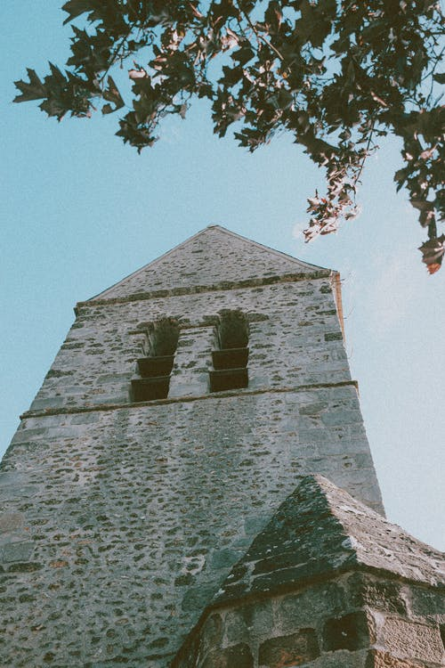 Old stone tower under cloudless sky