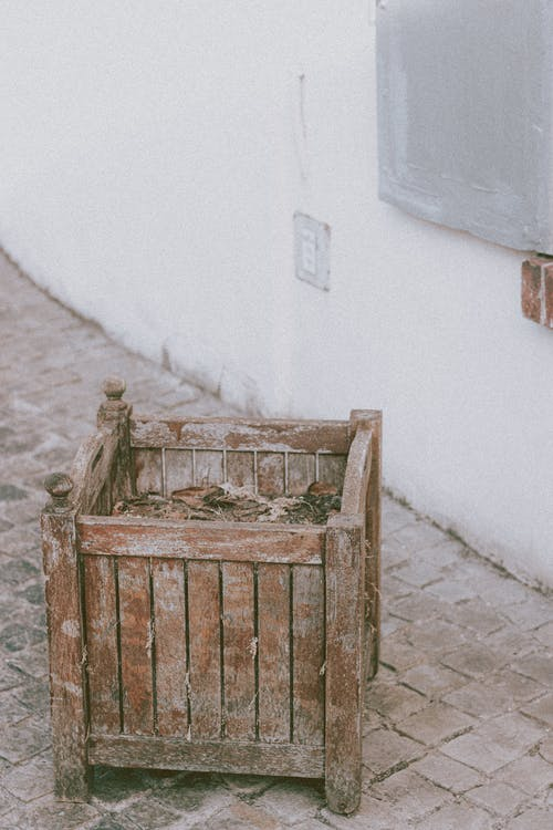 Rubbish in wooden square basket