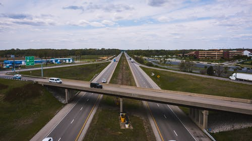 Drone view of cars riding along highway