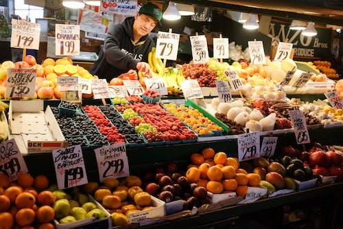 Ethnic vendor selling assorted fruits in local bazaar