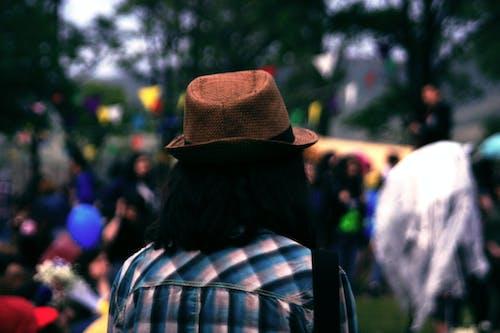 Person Wearing Brown Fedora Hat