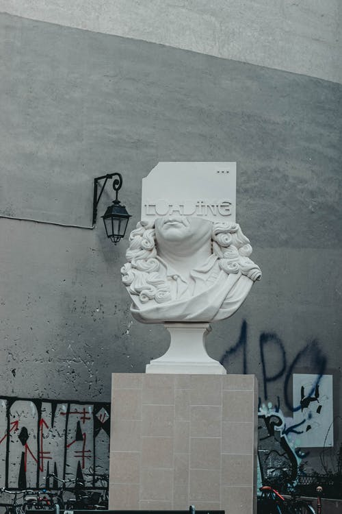 Statue of half of head of person