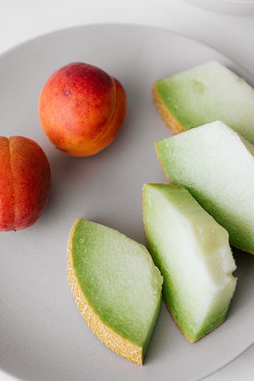 Gratis stockfoto met abrikoos, artikel, bord, deel