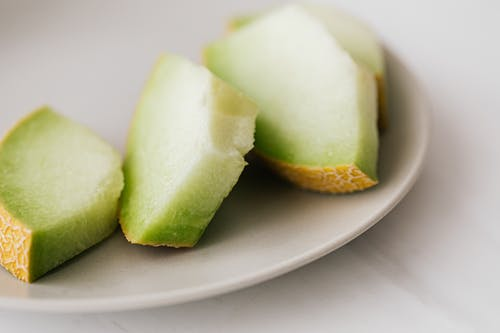 Slices of melon placed in plate