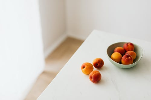 Fresh apricots placed on white table