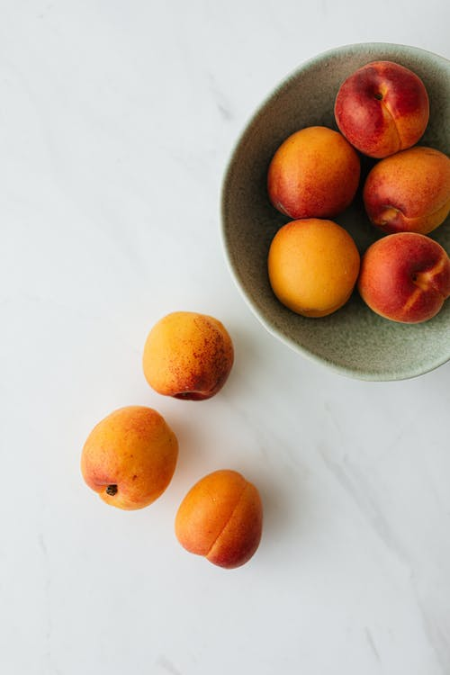 Fresh ripe fruits in bowl on table