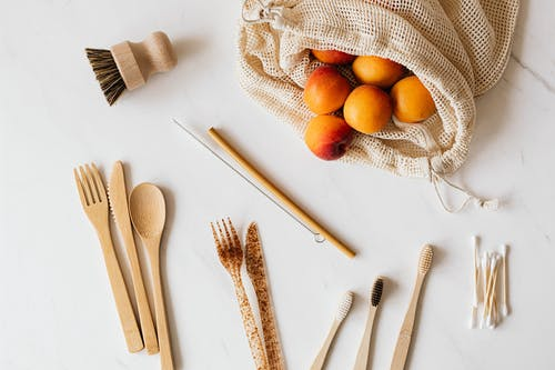 Set of various cutlery and wash accessories near peaches