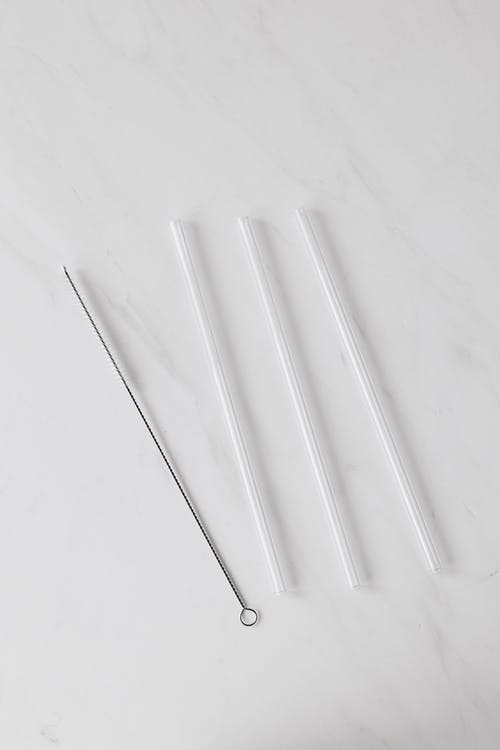 Set of tubes with brush on white background