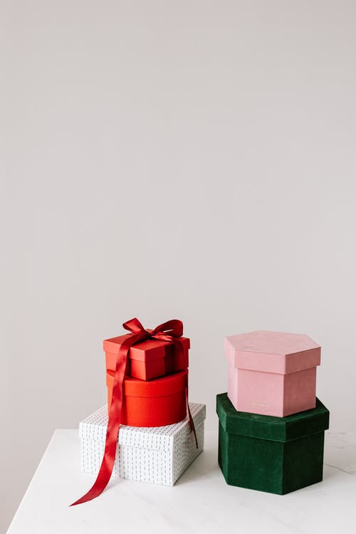 Different gift boxes placed om each over on white table