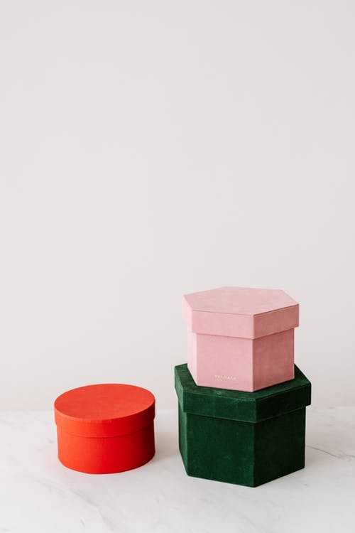 Gift boxes of different colors on table