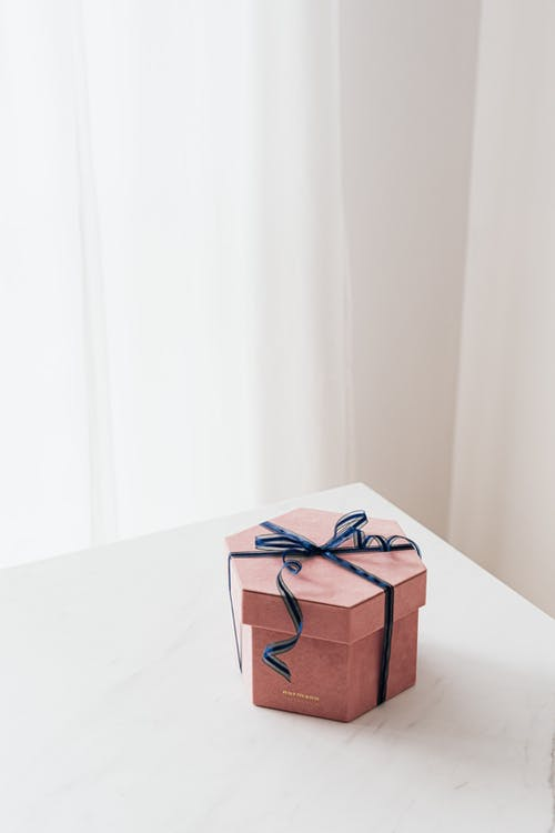 Wrapped with ribbon gift box placed on table