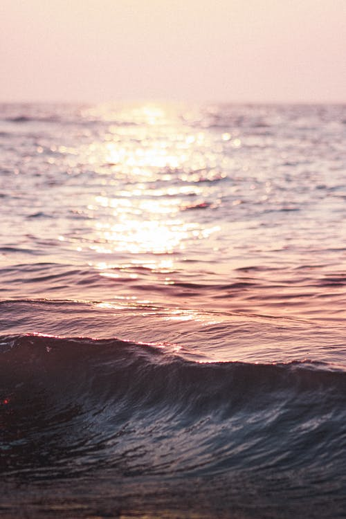 Waving sea with reflection of sunshine in water