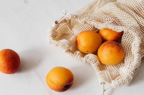 Orange Fruit on White Marble