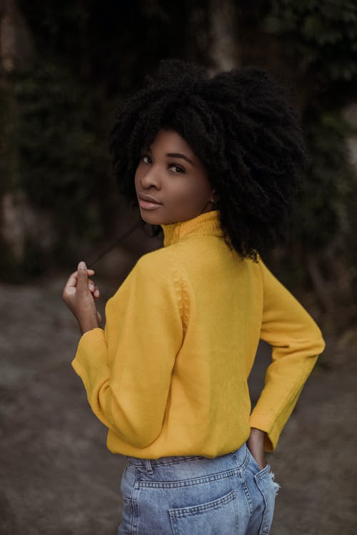 Girl in Yellow Sweater Holding Her Hair