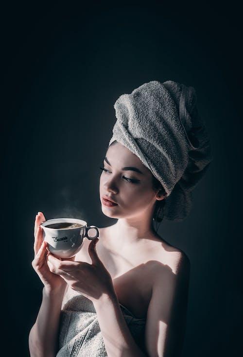 Sensual woman with mug of hot coffee