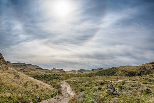 Narrow pathway among mountainous terrain