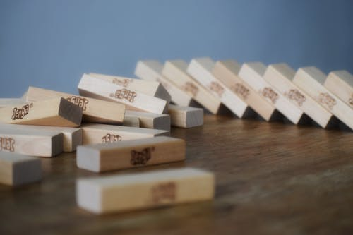 Board game with wooden blocks dropped and scattered on table chaotically after playing