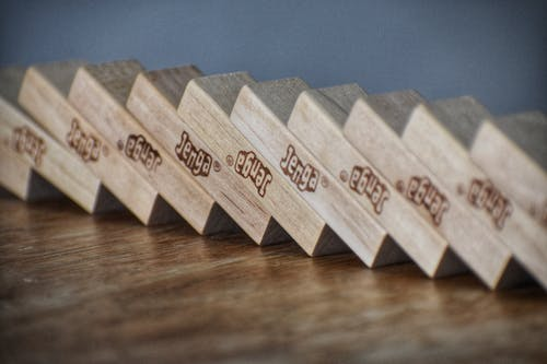 Wooden blocks placed in row on table