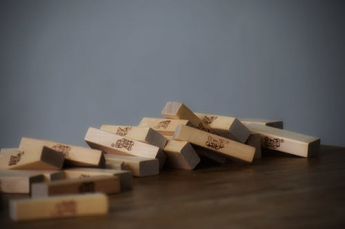 Party game with wooden blocks scattered chaotically
