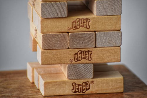 Wooden blocks stacked upwards on table