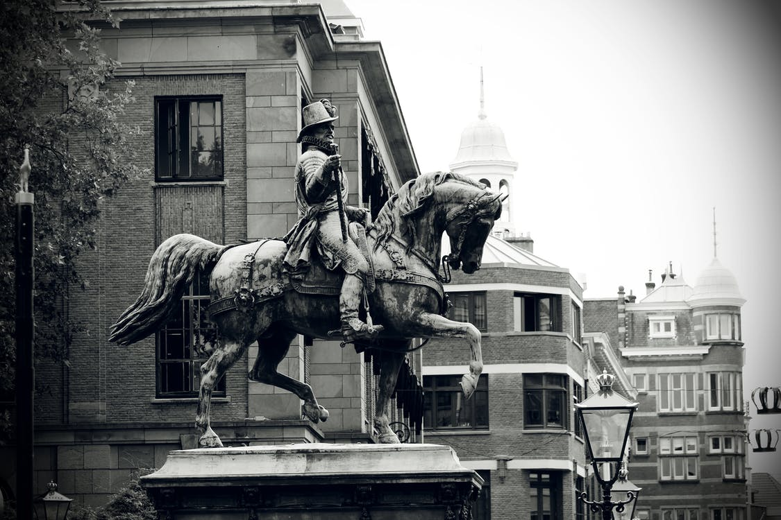 Grayscale Photography of Man Riding Horse Statue