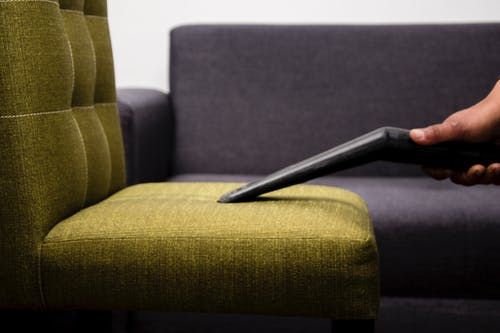 Black Pen on Brown Sofa