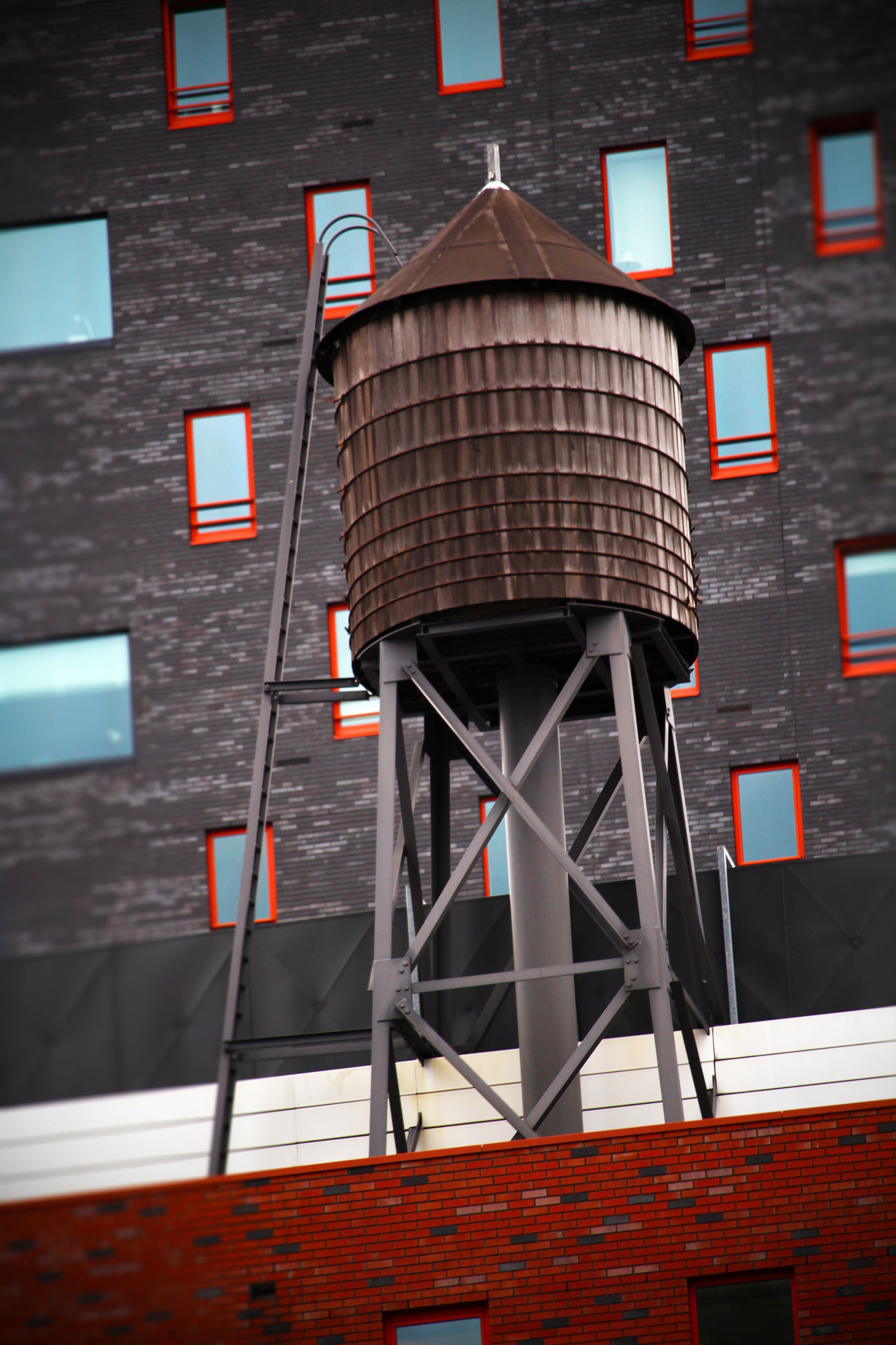 Brown Water Tower on Rooftop