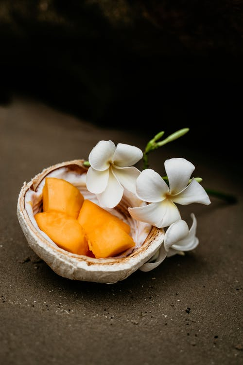 White Flowers on Brown Wooden Bowl