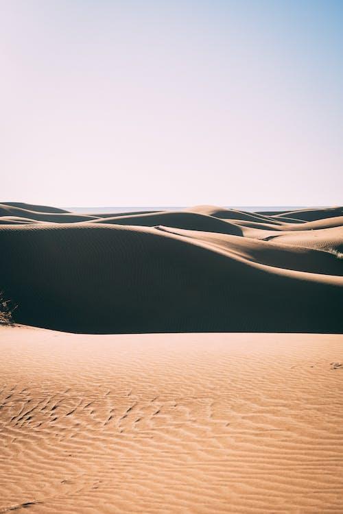 Brown Sand Under Gray Sky