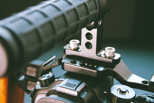 Camera stabilizer with metal and plastic parts
