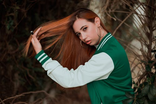 Woman in Green and White Long Sleeve Shirt