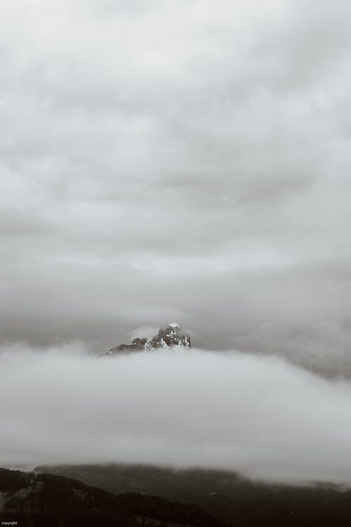 Foggy sky over mountains on overcast day