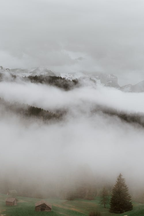 Mountain peaks under thick fog