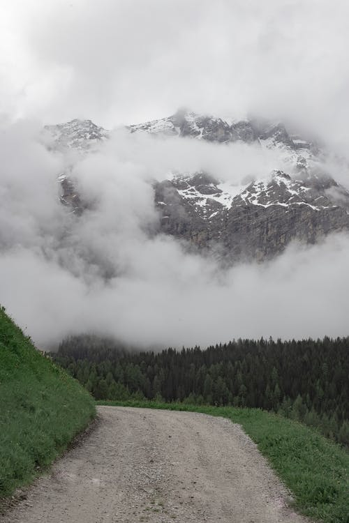 Green Trees Near Mountain Under White Clouds