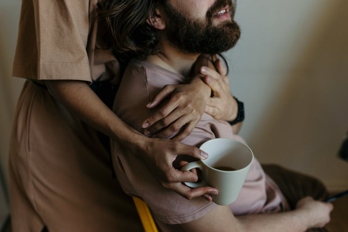 Photo Of A Man Being Hugged