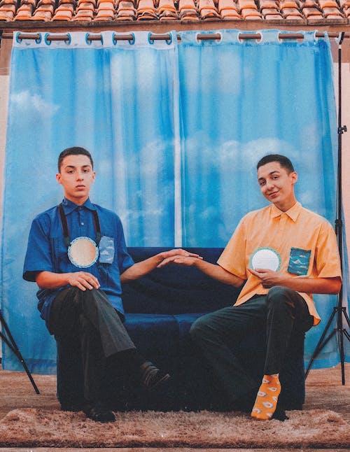 2 Men Sitting on Chair