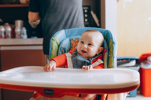 Happy smiling little kid in kitchen