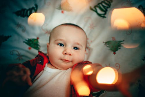 Little baby boy resting in crib