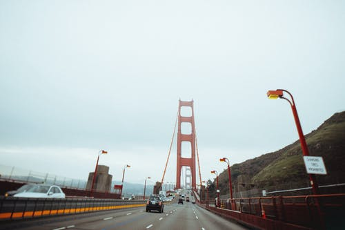 Majestic suspension bridge with moving cars