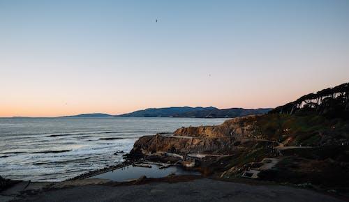 Peaceful rocky seashore in quiet evening