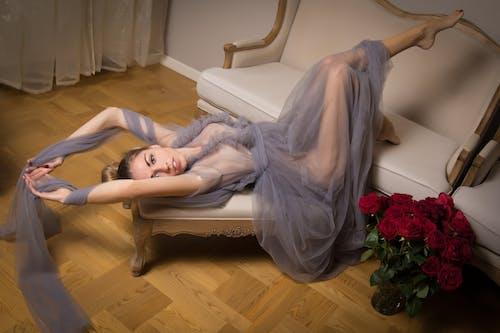 Woman in White Dress Lying on White Sofa