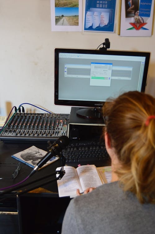 Unrecognizable sound engineer installing software on desktop computer at home