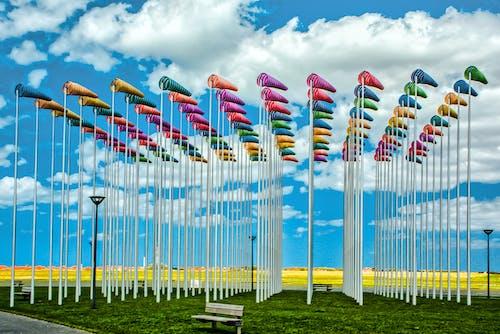 Free stock photo of bauschige wolken, bewölkter himmel, blauer himmel, fahnenmast